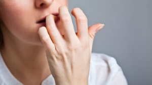 What nail biting really means, according to psychology