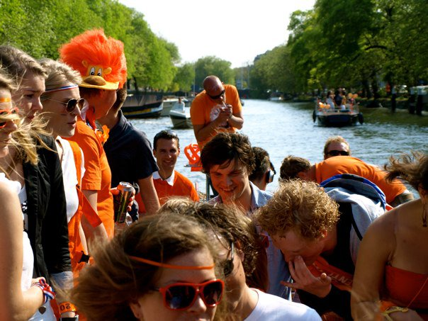 King's Day is celebrated on boats in the canals of Amsterdam. Credit:  Floris Heuer