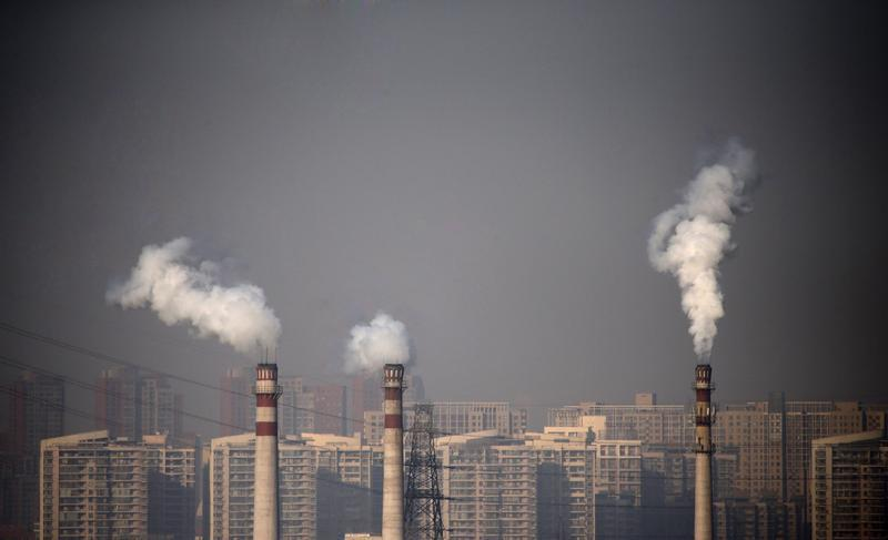 Smoking chimneys in front of residential buildings in Tianjin, China, Jan. 17, 2013. Credit: Reuters/Petar Kujundzic