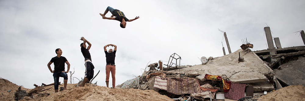Adolescent boys in Gaza practicing parkour, a sport skill around obstacles. Source: Alessio Romenzi/UNICEF