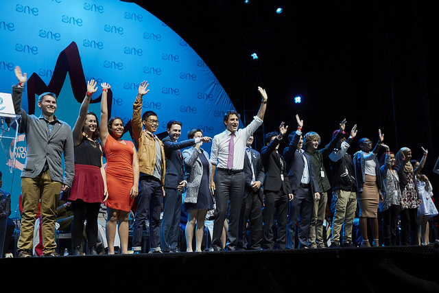 Canadian Prime Minister Justin Trudeau on summit stage with country delegates from around the world. Credit: One Young World via Flickr