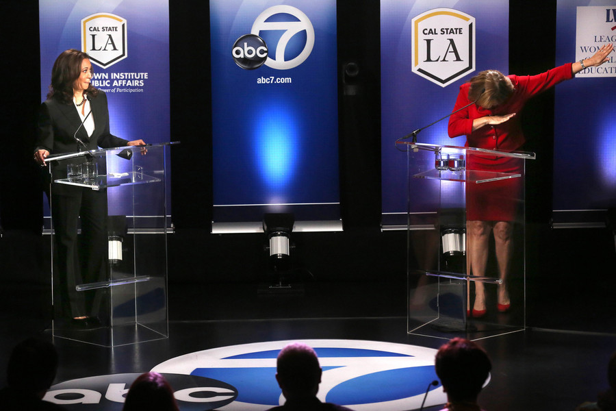 "California Senate race candidate Loretta Sanchez (right) ""dabbing"" on debate stage next to opponent Kamala Harris. Cover source:  LA Times"