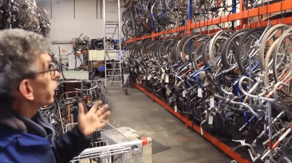 Still from the winning video reportage showing the warehouse where volunteer bikers can build, buy, sell, rent and fix their bikes. Source:  YouTube