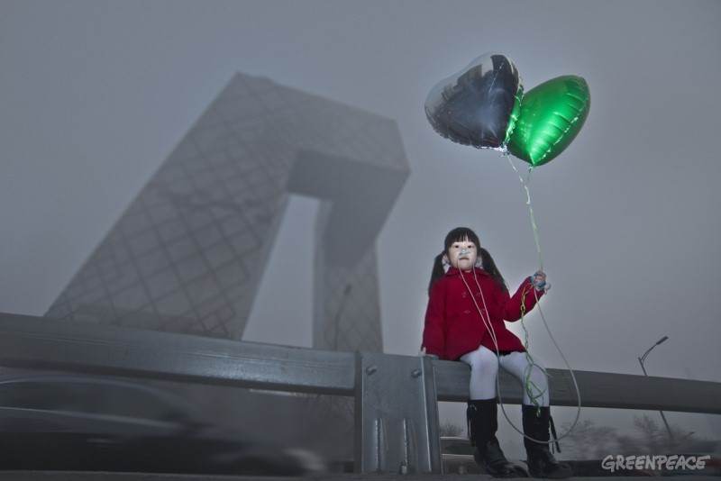 A girl with a balloon and special breathing devices in Beijing in 2013, which saw the severest smog since PM2.5 was officially monitored in 2011. Credit: Greenpeace