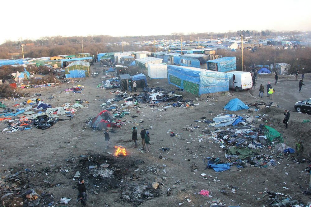 The refugee camp in Calais, France, before it was completely demolished. Cover credit:  Wikimedia