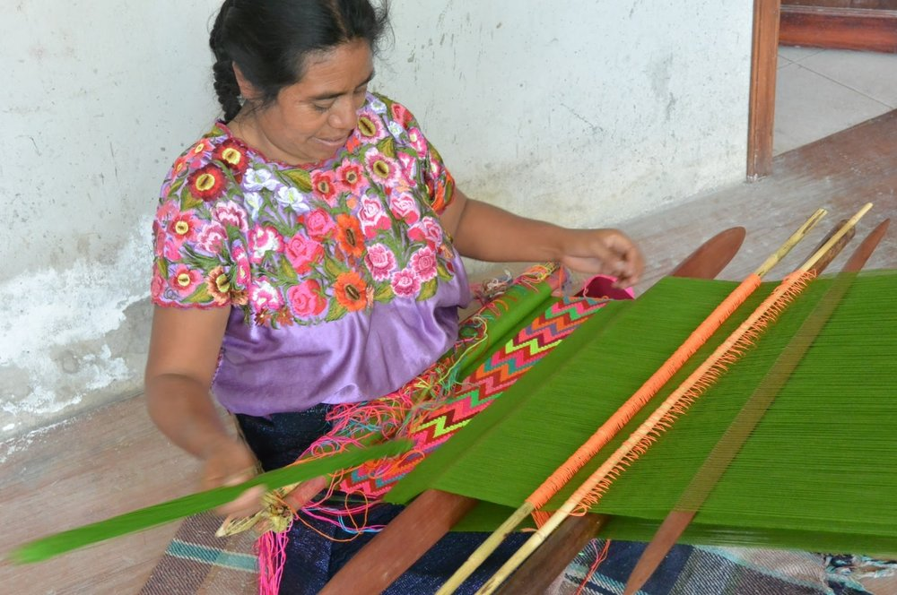 A Mexican woman working on traditional embroidery. Credit: Someone Somewhere staff