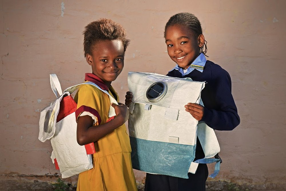 Pupils holding their Repurpose Schoolbags. Source: Facebook