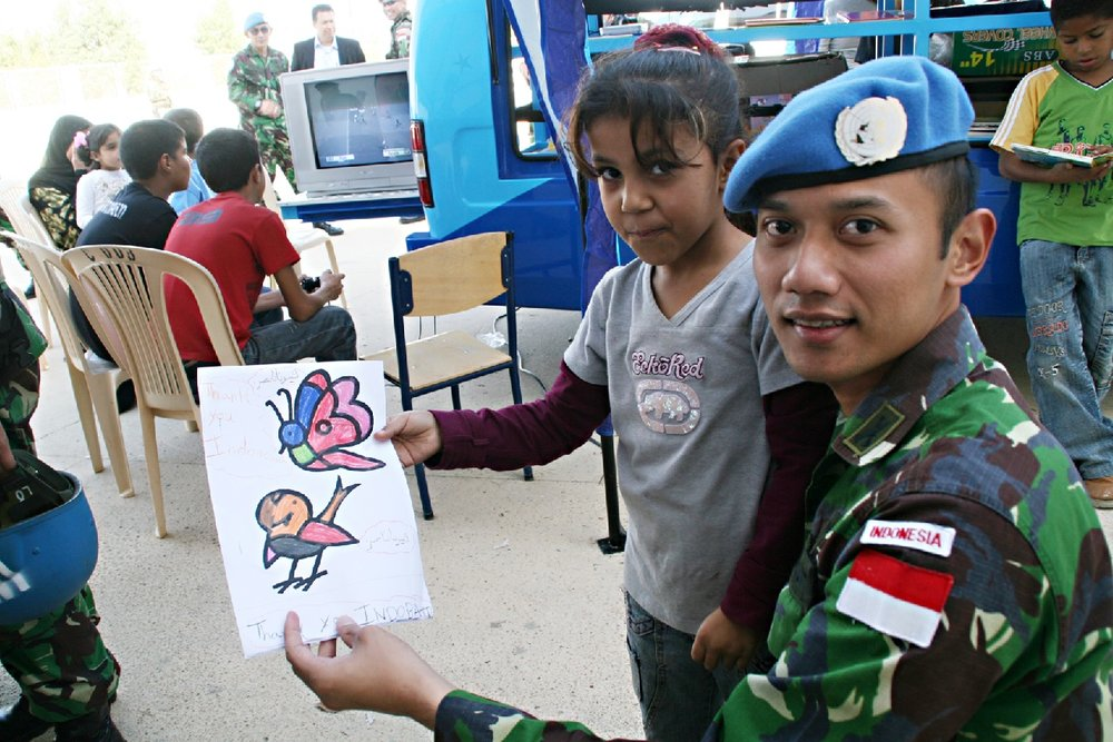 Candidate Agus Harimurti Yudhoyono socializes with Lebanese children in South Lebanon as part of a mission with the UNIFIL (United Nations Interim Force in Lebanon). Cover credit:  Wikimedia