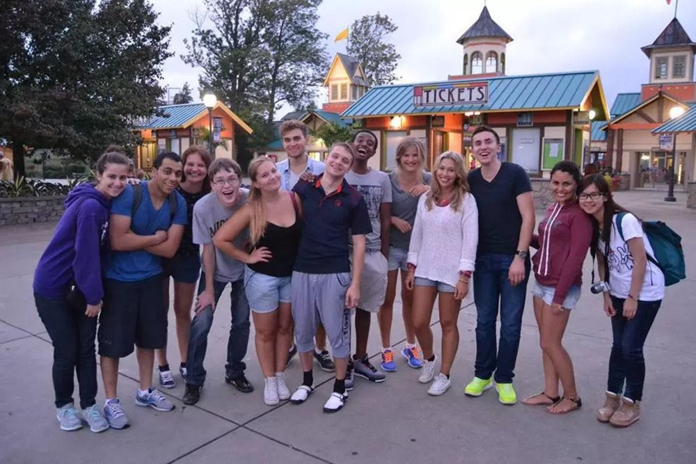 International exchange students of Utica College spending time at Darien Lake Amusement Park in New York, U.S., in September 2013. Among the nationalities in the photo are Lebanese, Egyptian, Polish, Finnish, Ukrainian, Albanian, Ethiopian, Chinese, Peruvian and Scottish.