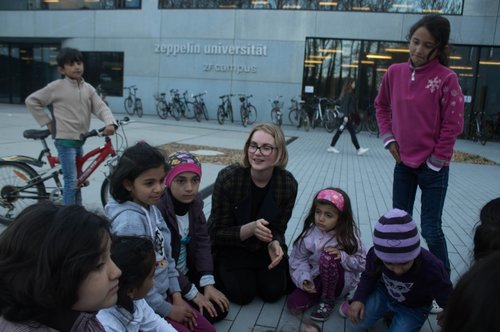 Zeppelin Universität students spend time with refugee and immigrant kids on campus.