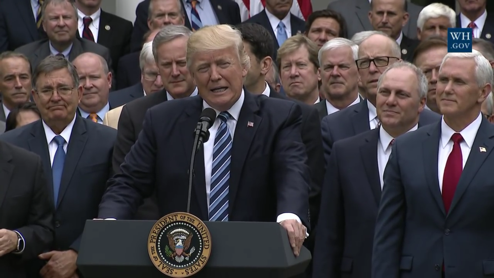Trump and other Republican leaders celebrating at the White House the U.S. House passage of the AHCA. Source:  Wikimedia