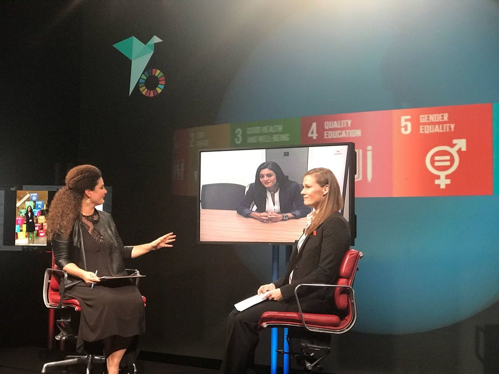 Hazami Barmada interviews Heba Aly, head of IRIN News, and Sally Roberts, founder of Wrestle Like A Girl, as part of the summit. Credit: Global People's Summit