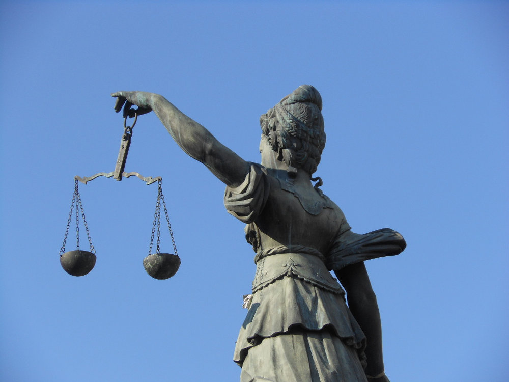 Scales of Justice in Frankfurt, Germany Credit:  Michael Coghlan / Flickr
