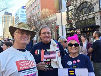 Dr. David Compton (center) with two friends at Knoxville's Women's March