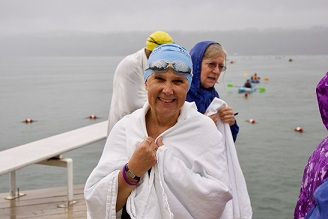 Wrapping up a swim across Cayuga Lake that helped Hospicare raise $370,000
