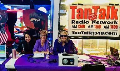Linda (center) broadcasting from a local bowling alley