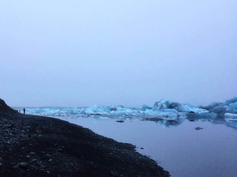 Stillness, and a beach of black sand, surround the blue Ice
