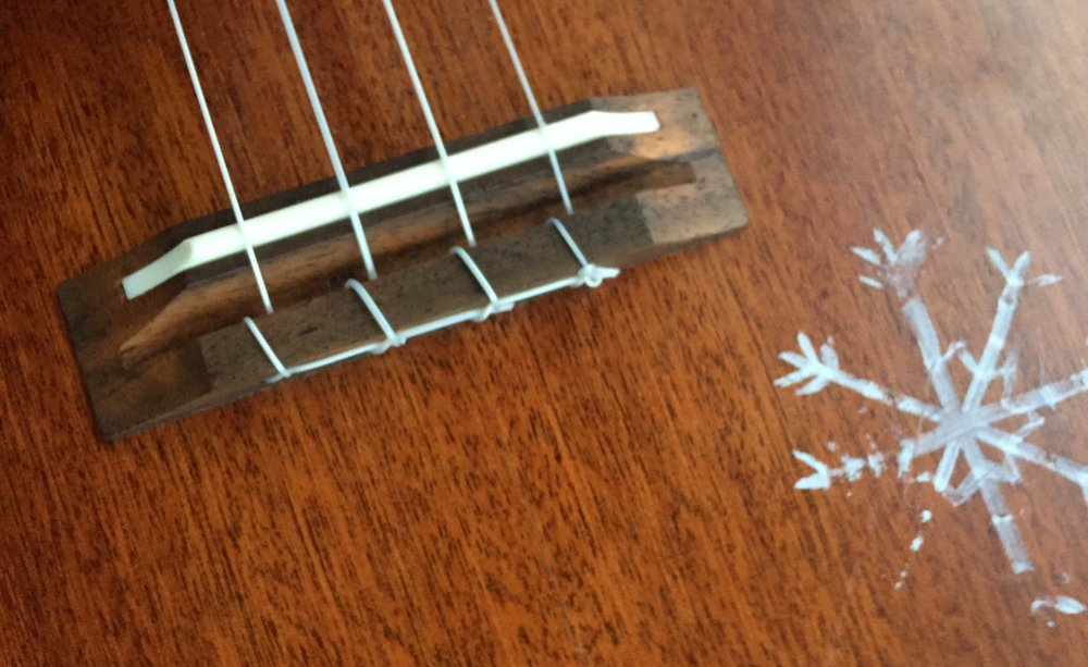 Closeup of a snow flake on my tenor uke drawn by an art student in Reykjavik.