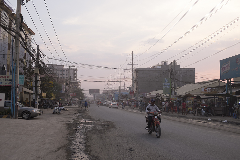 Phnom Penh city, where there is no such thing as a sidewalk - just more road.
