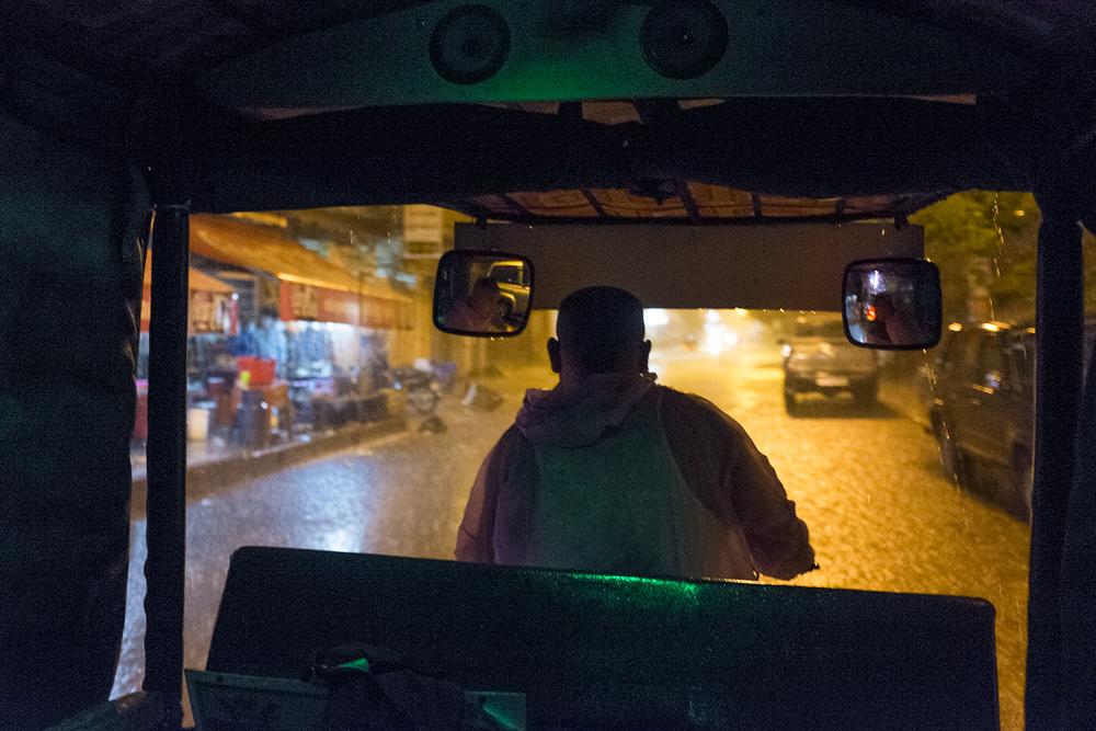 Our Tuk-Tuk driver, Mr. Shy, battling the heavy rain.