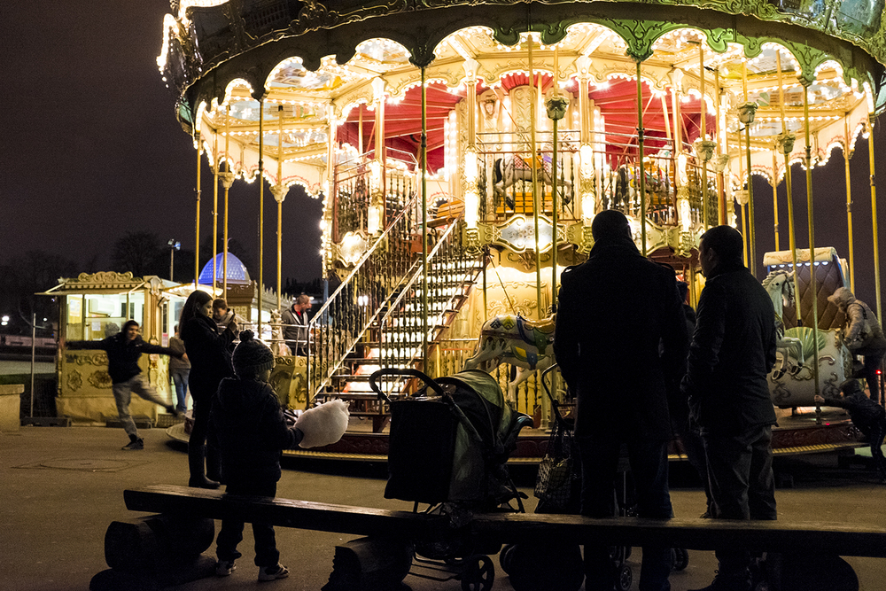 A merry-go-round by the Eiffel Tower.