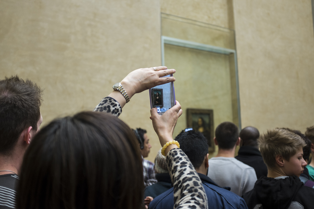 A huge sea of people and the Mona Lisa.