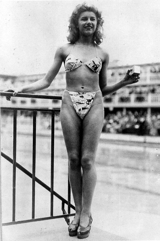 Micheline Bernardini modeling one of the first modern bikinis.