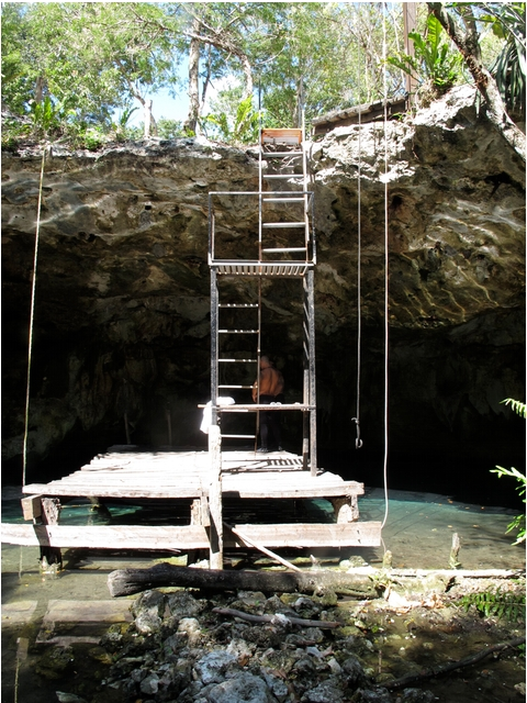 Lowering tanks down to the Cenote.