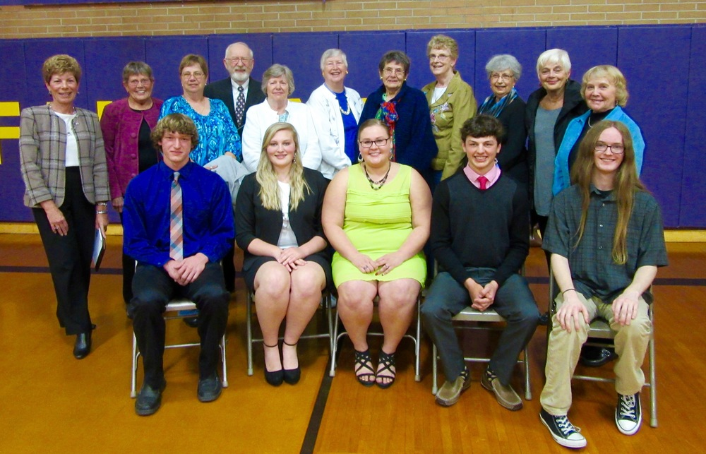 The five scholarship recipients for the 2014-15 year, seated left to right, are Nicholas Anscombe, Savannah Slikkers, Jordan Lucas, Sam Wagner and Tyler Quinn.  Members of the Scholarship Committee attended the Honors Assembly on May 13  th   to support the winners.  Standing, left to right, are 2  nd   Vice President Norma Oly, Scholarship Chair Kathy Davis, Deborah Atchette, Presenter Stanley Roose, President Sally Ouweneel, Betty Graham, Elaine Bell, Nancy Mertes, 1  st   Vice President Donna Renshaw, Treasurer Janet Nelson, and Judy Jankowski.