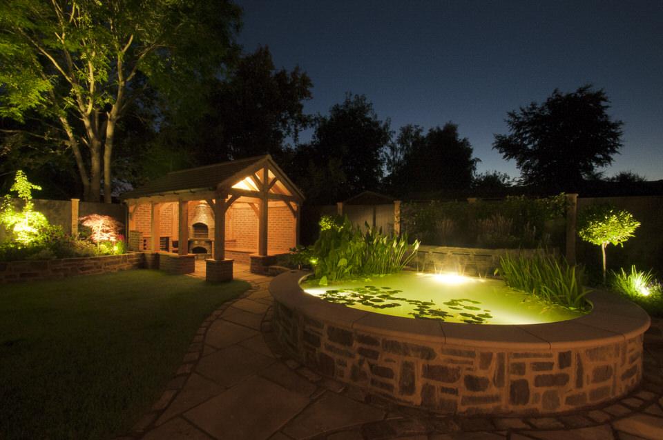 Garden with outdoor kitchen at night