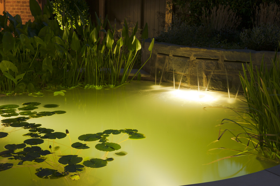 Pool with spillway water blades with submerged lighting
