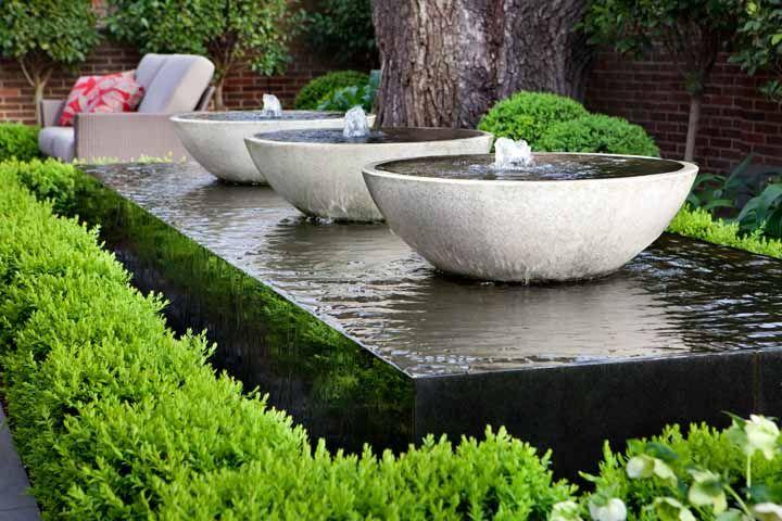 Overflowing water bowls on stone slab
