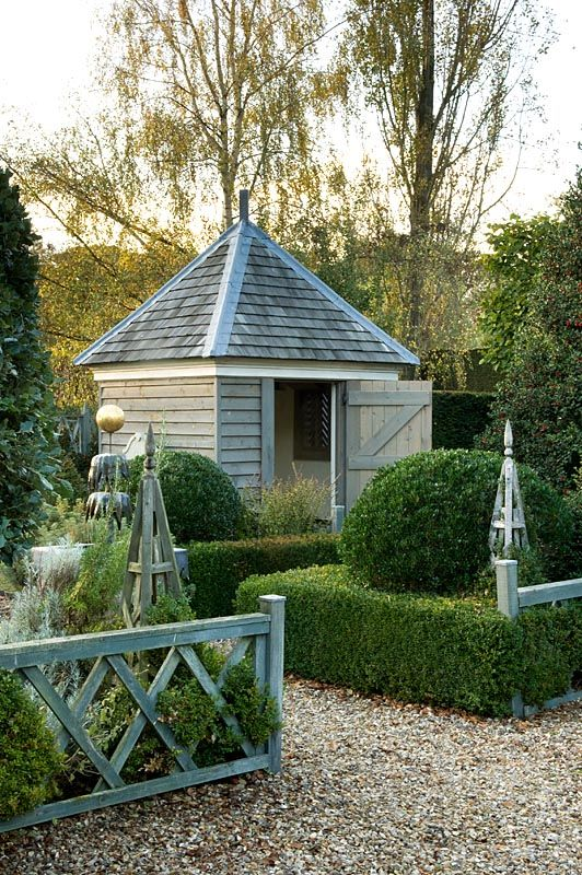 Summer house with box hedging