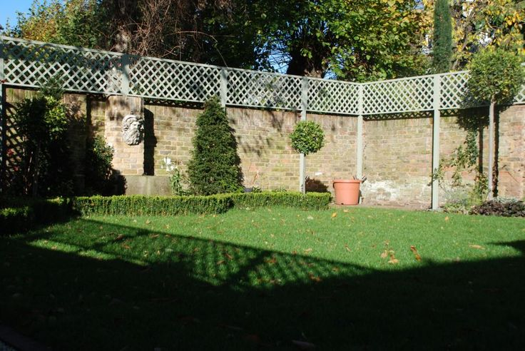 Trellis tops on wall to increase privacy