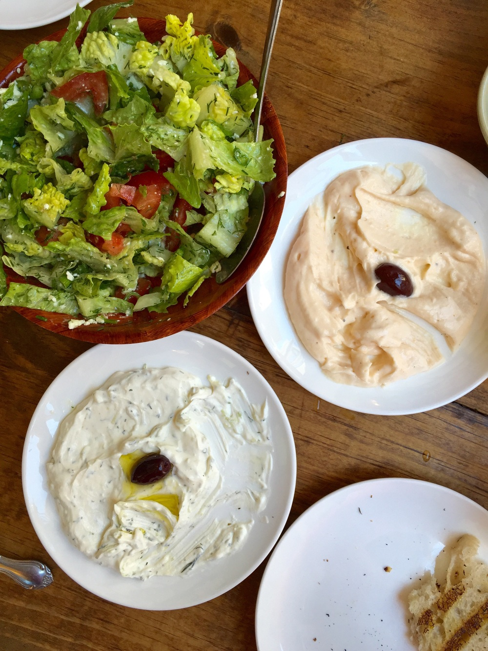 KiKi's  in Chinatown... Mediterranean food, adorable little space. By far, one of our favorite places in NYC. Pictured: one of our salads, roe dip, and a tzatziki dip!