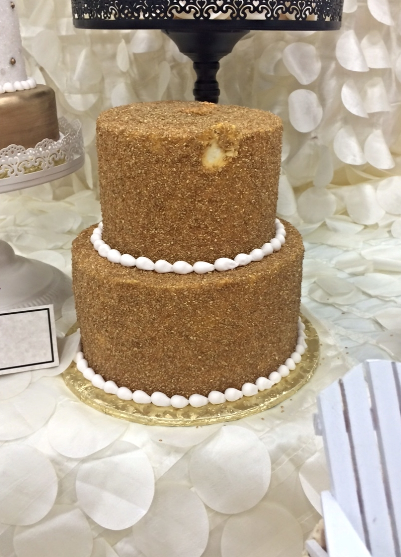 There were a bunch of fake cakes. I put my hand on this one, which was apparently not fake. Even though it looks like sawdust. Oops! Call the cake police.