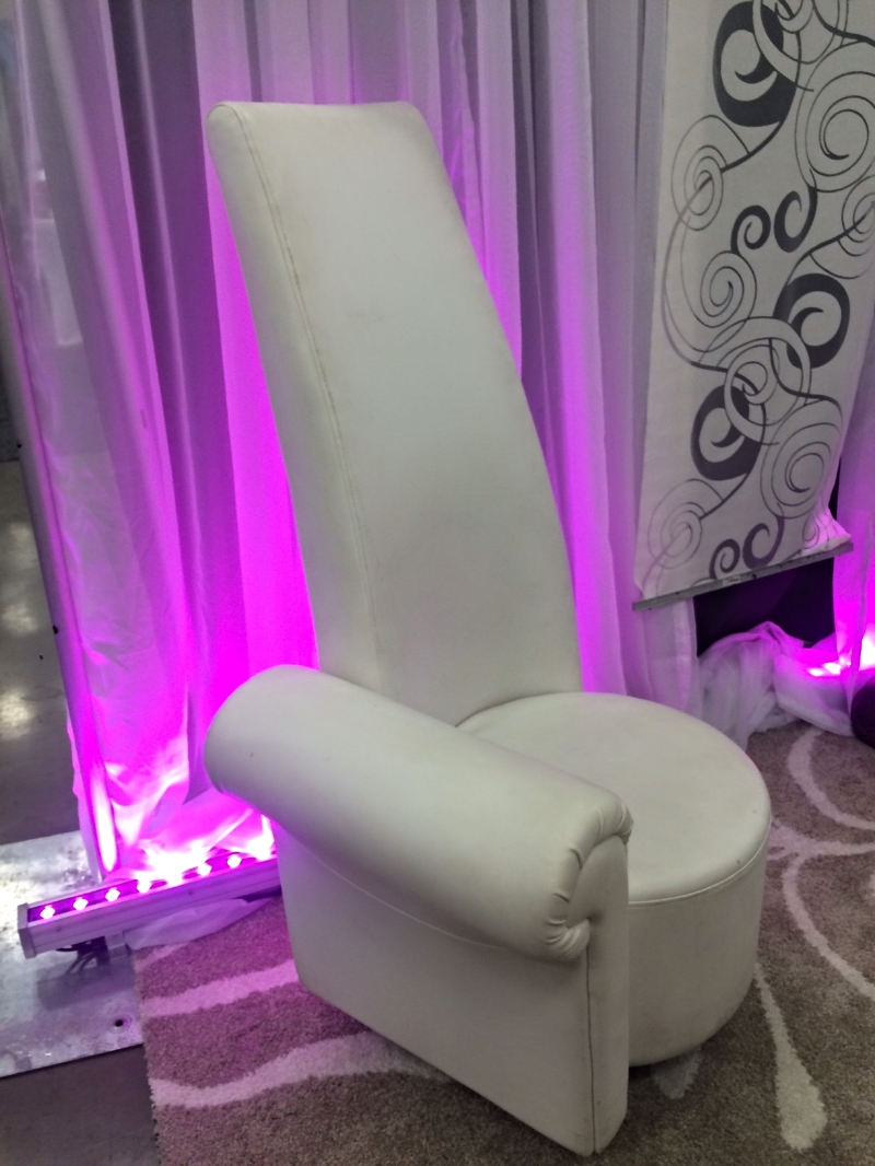 For all of your long-backed wedding guests.   This chair reminds me of Bette Midler's clothes in   Ruthless People .
