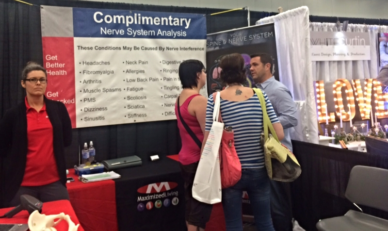 Weddings are the leading cause of fibromyalgia? Or do weddings clear up fibromyalgia? Not sure what they're saying. This booth should be called the   Wedding Jitters   booth. Get your nerves analyzed and maybe you'll prevent a divorce? I'm not married, and I have most of these: PMS, sinusitis, sciatica, nervousness, allergies, pain in shoulders? Check, check, check, check. Maybe if I got married they would disappear? I think a dedicated yoga practice also clears up most of these ailments.