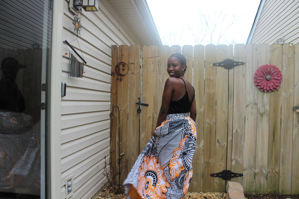 "My beautiful ""Adansi Skirt"" in Orange and Black is a signature piece from  Threads By Dreads  100% cotton fabric from Ghana and made in Ghana!"