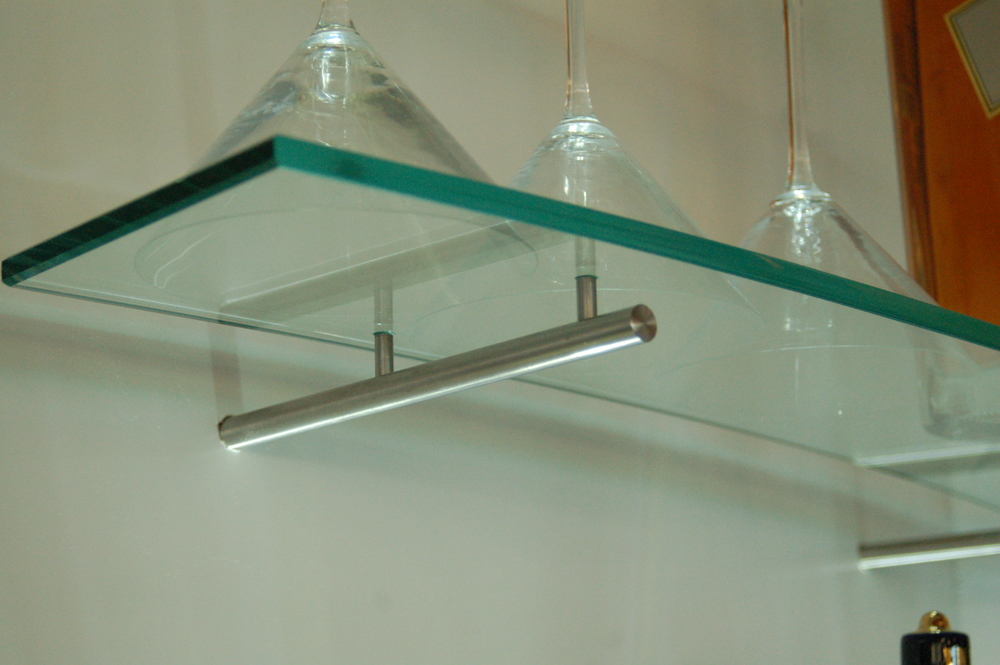 Glass shelf detail at bar