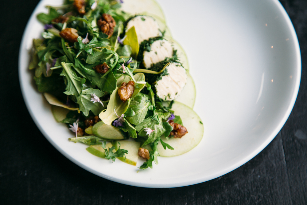 Arugula salad with herbed cashew cheese and candied walnuts