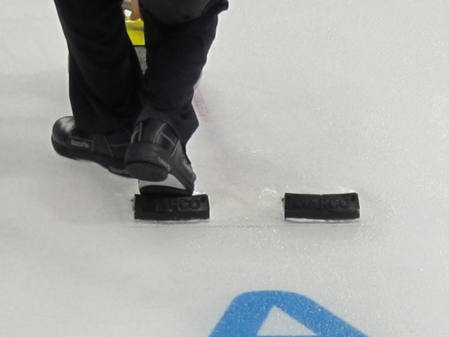 There are little starting blocks from which the curlers push off when sliding the stone.