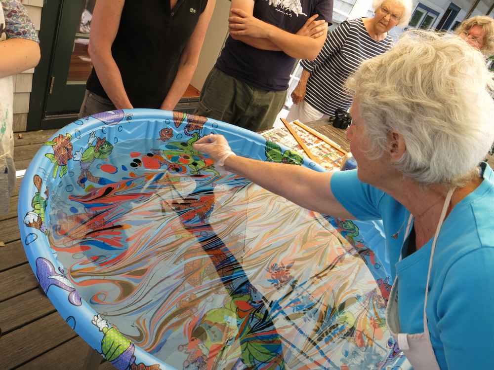 In fact, here's Shira Singer leading a marbleizing workshop last summer. We created planets!