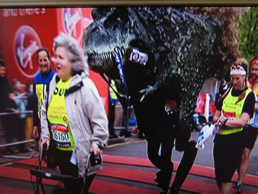 Ian Bates, 44, from Crawley, England, ran wearing a T-rex costume that weighed 84 pounds.