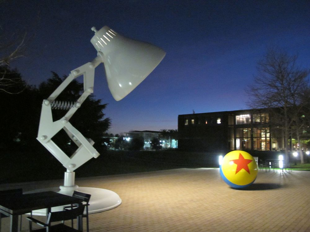 In a plaza outside the Steve Jobs Building sits large model of Luxo Jr., one of the two table-lamp stars of Pixar's famous 1986 animated short of that same name, and now the symbol of the company. As you can see, Luxo Jr. lights up at night.