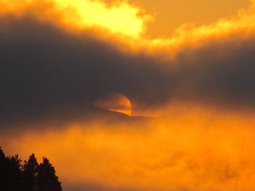 Here the Sun begins to peek over Sargent Mountain. One of Discover magazine's top 100 science stories of 2012 was the Sun's Aug. 31 expulsion of a gigantic cloud of 100,000-degree plasma (ionized gas) that traveled 900 miles per second and was as long as 30 Earths put side by side. The magazine notes that in 2013 the Sun will be at the peak of its 11-year cycle of solar activity, so more amazing eruptions and auroras could be in store (and might bedevil satellites).