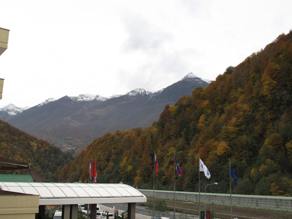 While we received heavy rain all day yesterday, snow fell farther up the mountains, giving Sochi a Winter Olympic look for the first time.