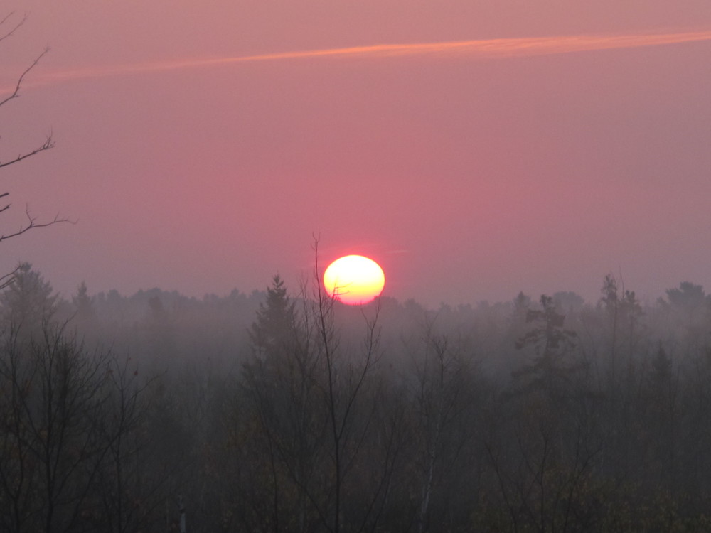 But returning home is always enjoyable too. This was the first Maine sunrise we saw, while driving north from Boston.