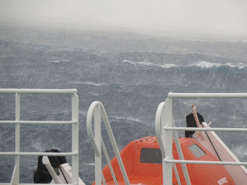 ...and oh, yeah, it started to snow heavily. That orange pod is one of the lifeboats, designed to sardine-pack 56 passengers, an adventure we hoped not to experience.