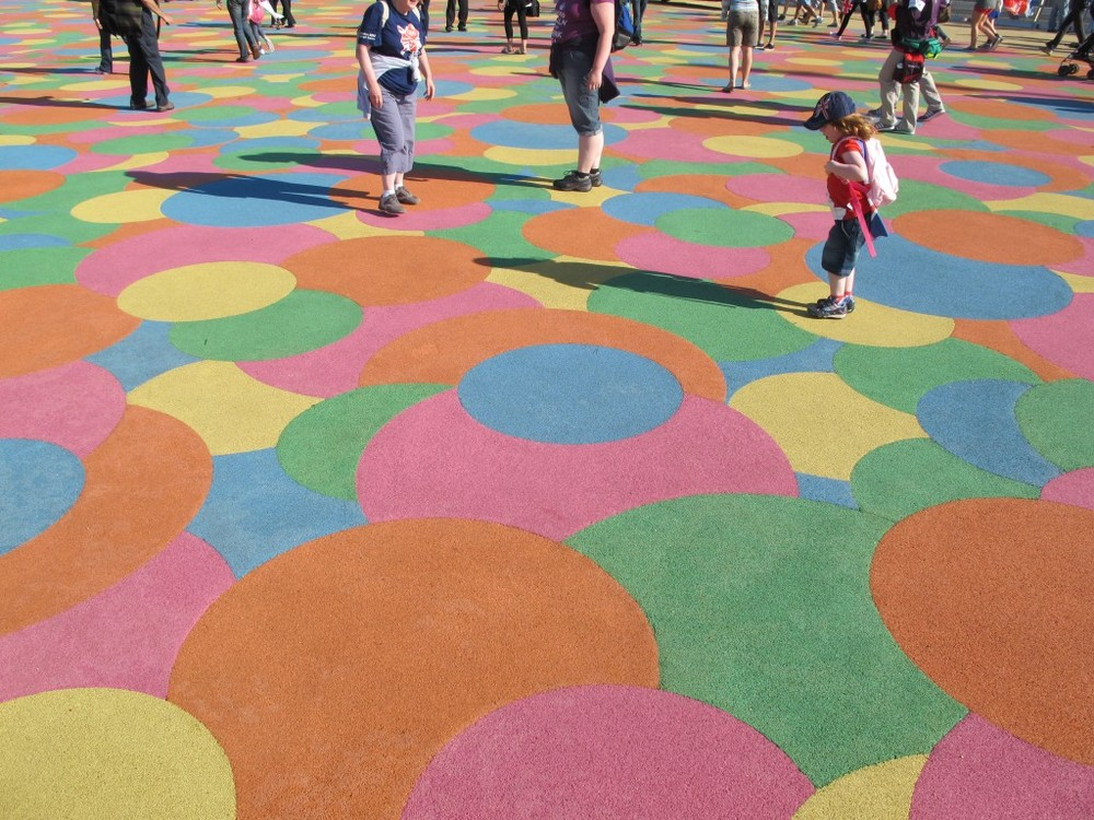 Here's that area of overlapping colored dots. Kids—and some adults—can't resist trying to jump from one dot to another of the same color. The surface is made of recycled sneaker soles.